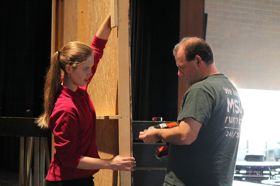 Senior Hannah Friend and her father Scott Friend drill screws into a flat on Saturday. Nov. 5.