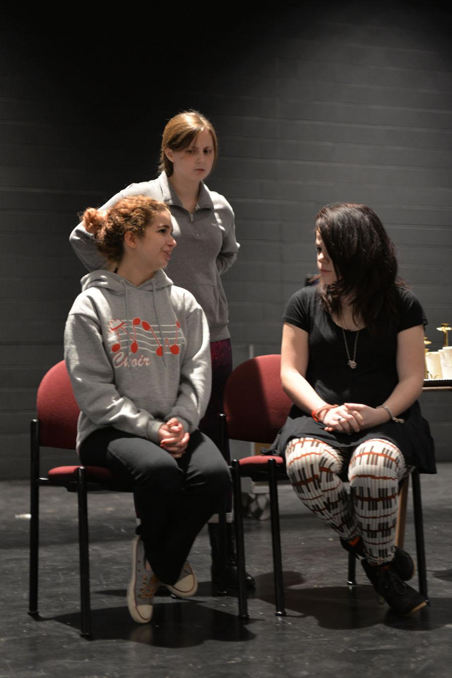 Senior Sophi Epstein, senior Genna Barner, and junior Kate Romkee rehearse a scene where Elaine is angered by the Aunt's belief that they are murdering people out of mercy.