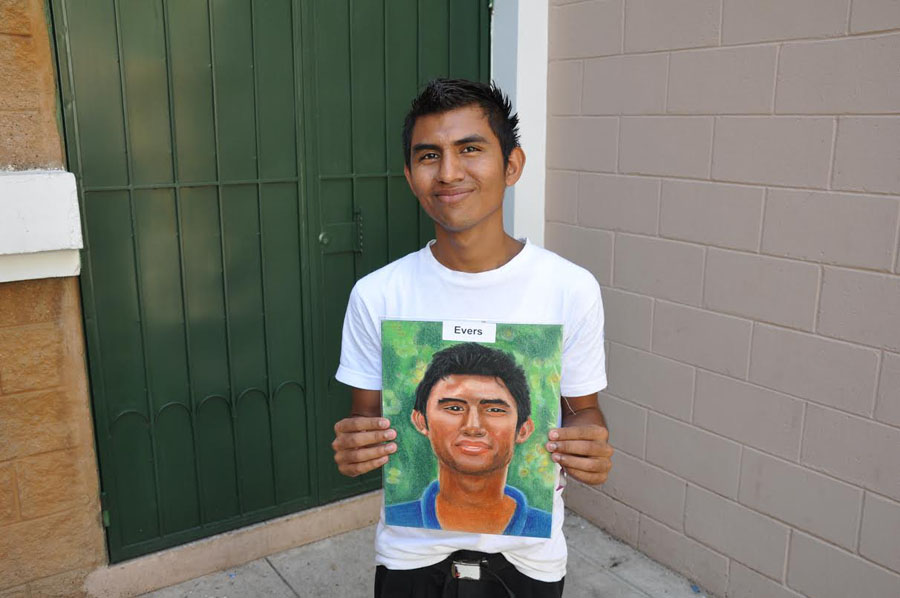 An orphan holding a portrait painted by a Northwest student