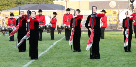 The Marching Mounties stand at attention ready to start their performance