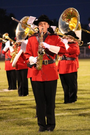 Senior Alec Richmond plays a solo during half time