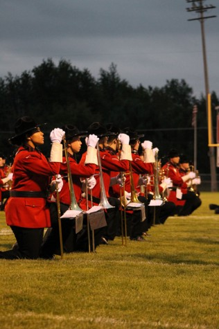 The Marching Mounties kneel down during there half time show