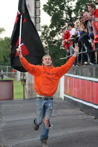 Senior Elijah McArthur runs  in front of the student section during a football game