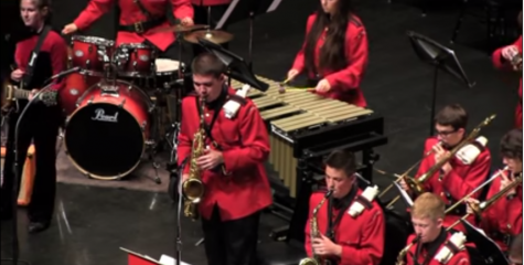 Junior Michael Layher stands for his solo during mountie montage