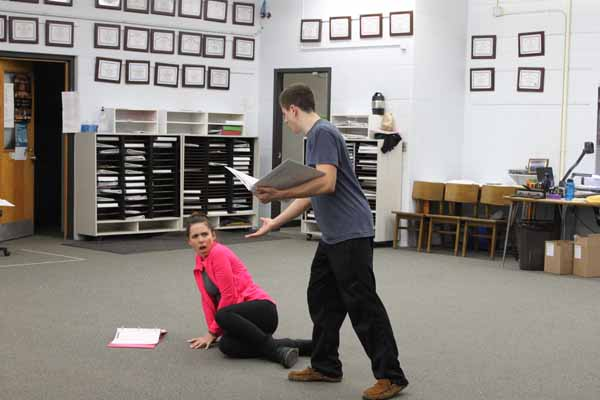 Senior Olivia White and Brian Lewis act our their parts for the musical Beauty and the Beast