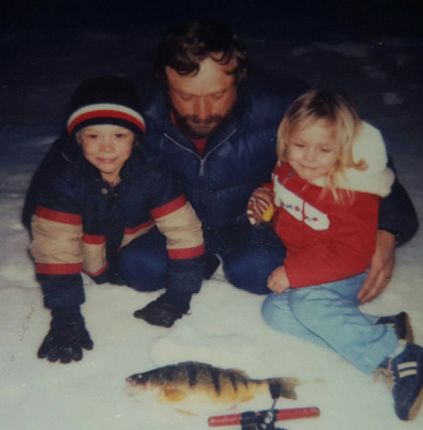 Mrs. Rebecca Bortnichak, 3,  poses with her father and brother after she caught her first fish while ice fishing.