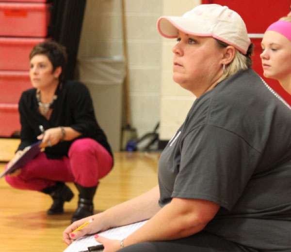Head coach Amanda Anspaugh (left) and assistant coach Debbie Bevier (right) look on as their team plays a match at Vandercook high school.