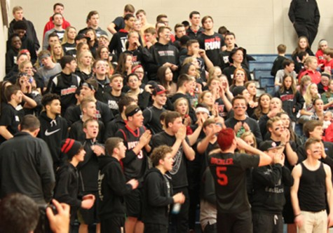 The Northwest Student Section cheers on the team during the game.