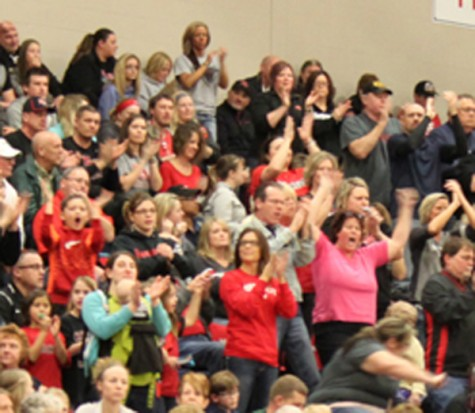 Family and friends cheer on the girls after scoring.