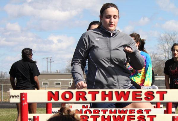 Sophomore Courtney Johnson runs through hurdle warm ups.