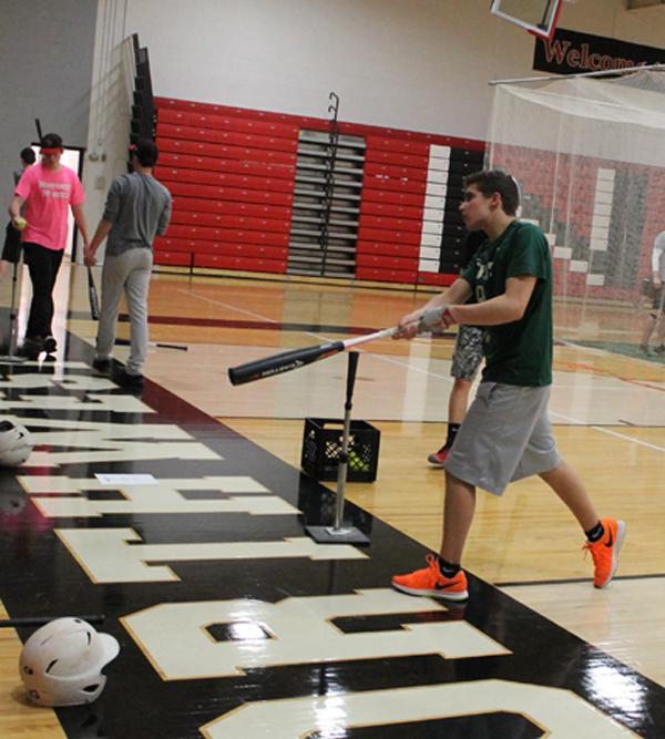 Freshman Sawyer Epstein practices swinging his bat.
