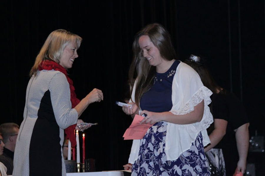 Mrs. Randi Watts and junior Maddie Miller welcomes Miller into NHS last fall. NHS inducted around 40 members last year.