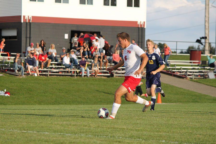 Senior+Zach+Wohlart+tries+to+score+a+goal+past+the+opposing+teams+goalie.+