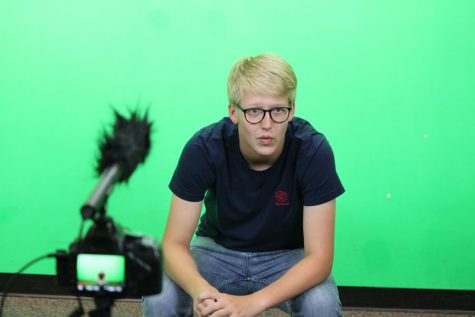 Shaw records a vlog using Miss Marnie Hade's braodcast room. His video features a big announcement for his fans.