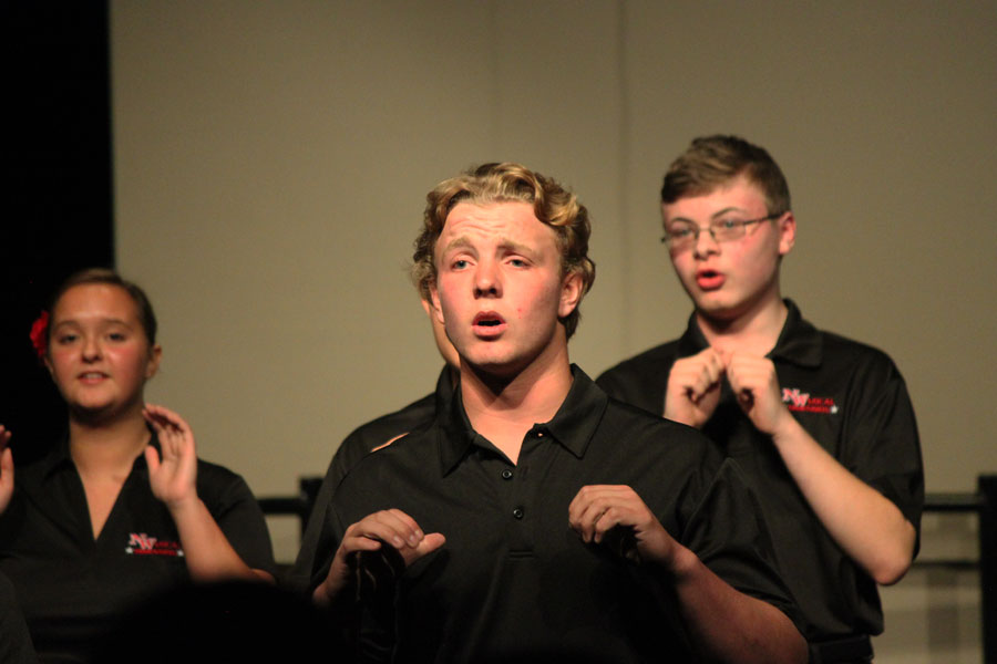 Third year Vocal Dimension member senior Noah Pieh uses hand gestures while singing.