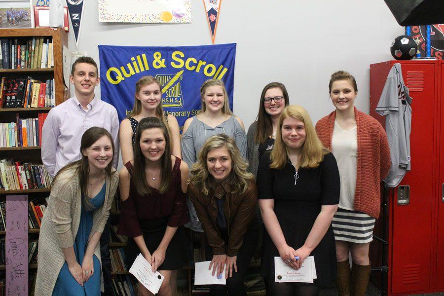 Quill and Scroll members pose for a picture after the induction.