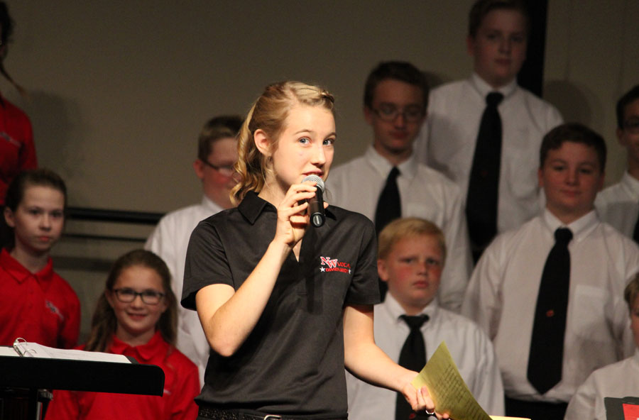 Charis Cummings introduces the Eschoir and Eighth Grade.