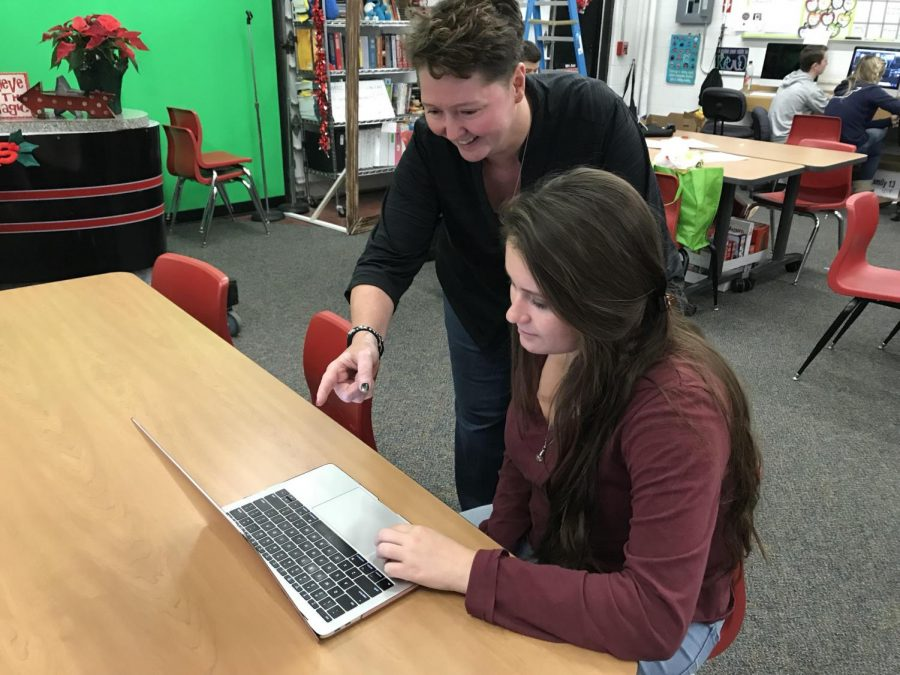 Adviser Miss Marnie Hade assists senior Rachel Nau with filling out her FAFSA during a College Information Night.