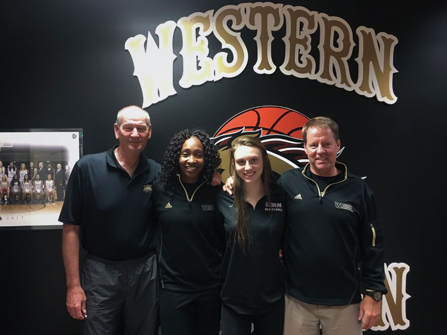 (Above)Sydney Shafer posing for a photo with her father, Doug Shafer, and the two assistant coaches from Western's Girls Basketball team after being offered a full ride scholarship for basketball.