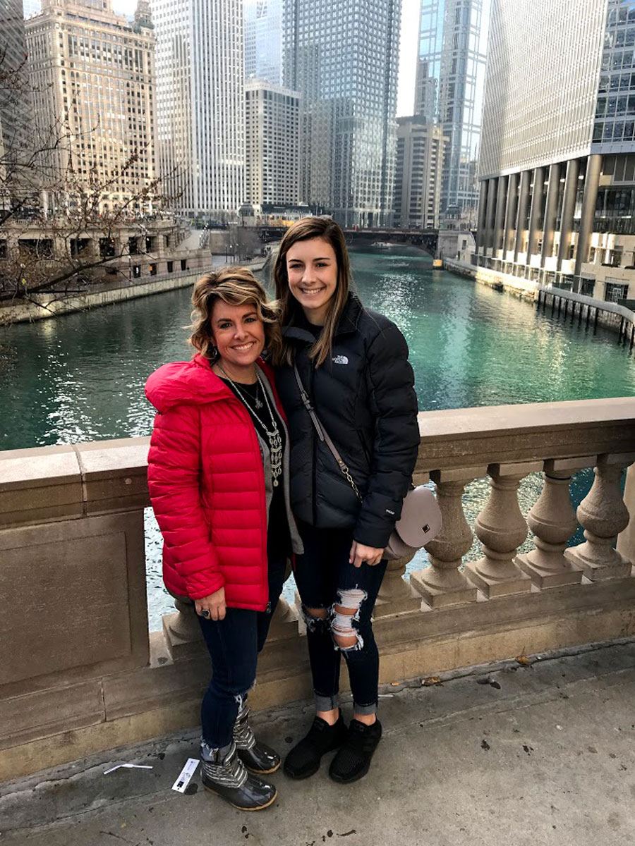 Mrs. Amanda Anspaugh smiles with daughter, Mallory Anspaugh, in front of  the Chicago River as they supported Project Graduation by participating on the trip.