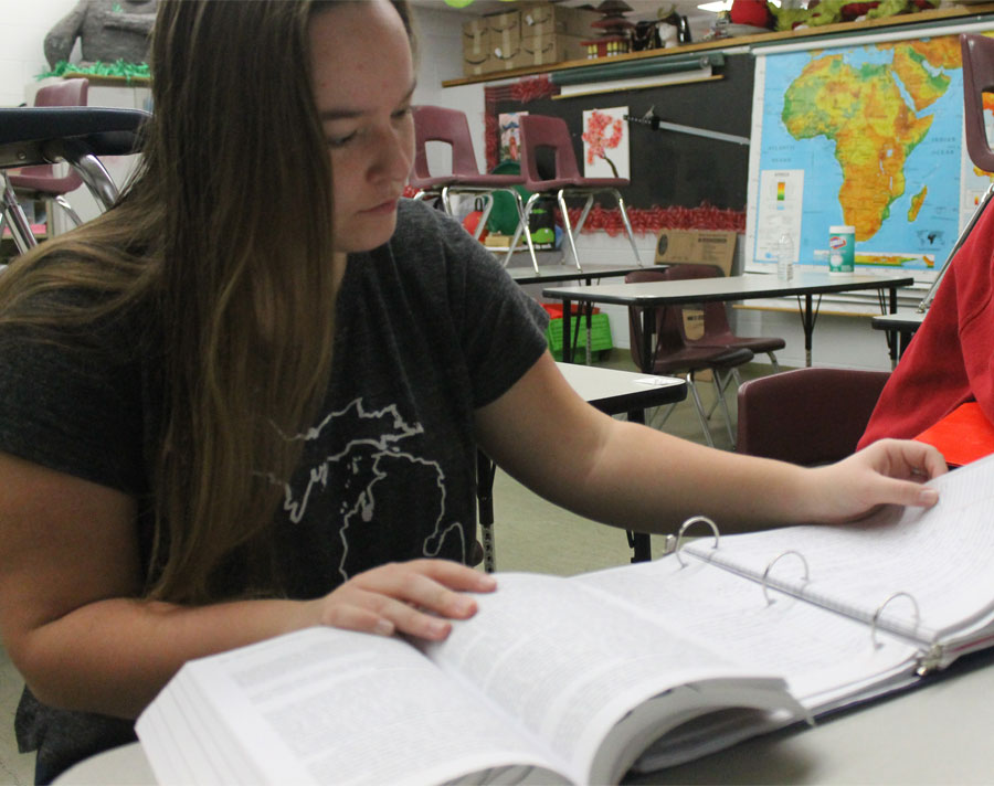 Senior Madelyn Miller reviews notes for AP US History before the class period begins.