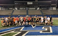 Northwest High School Varsity Football Team poses for a photo on their last day at GVSU