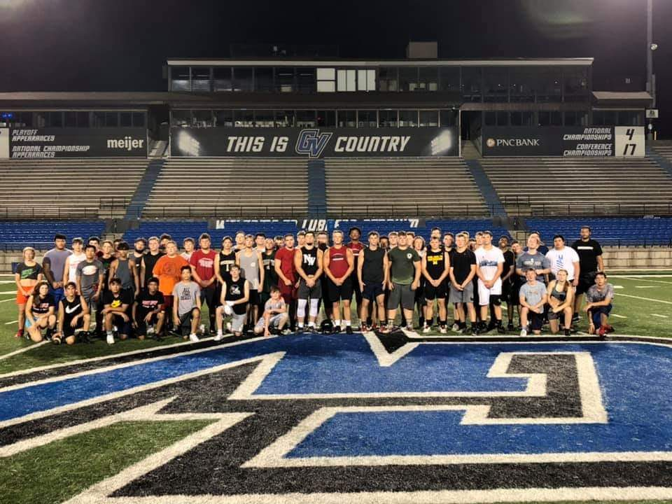 Northwest High School Varsity Football Team poses for a photo on their last day at GVSU